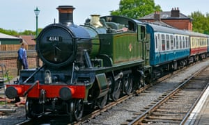 Ticket to ride: steam locomotive 4141 with train on the Epping Ongar heritage railway at North Weald station.