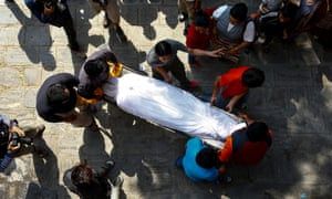 Family members carry the body of Ang Kaji Sherpa, who died in the Everest avalanche, at a monastery in Kathmandu, Nepal last April.