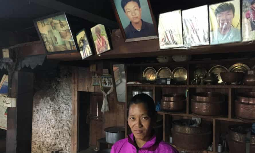Kandi Sherpa, widow of Pasang Karma Sherpa, who was killed the 2014 avalanche on Everest, beneath portraits of her husband in her home in Nepal.
