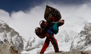 A Nepalese porter walks with his load from Everest base camp.