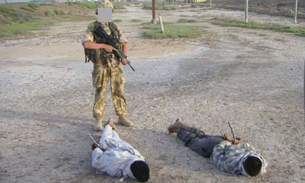 Iraqis being guarded by a British soldier that was shown at the Al-Sweady Inquiry, long-running inquiry into claims that British troops killed and tortured Iraqi civilians.