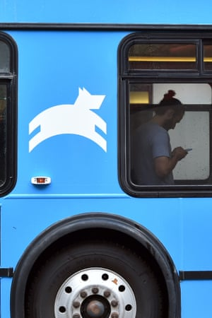 A Leap Transit employee checks his phone while riding on one of the company's new luxury buses in San Francisco