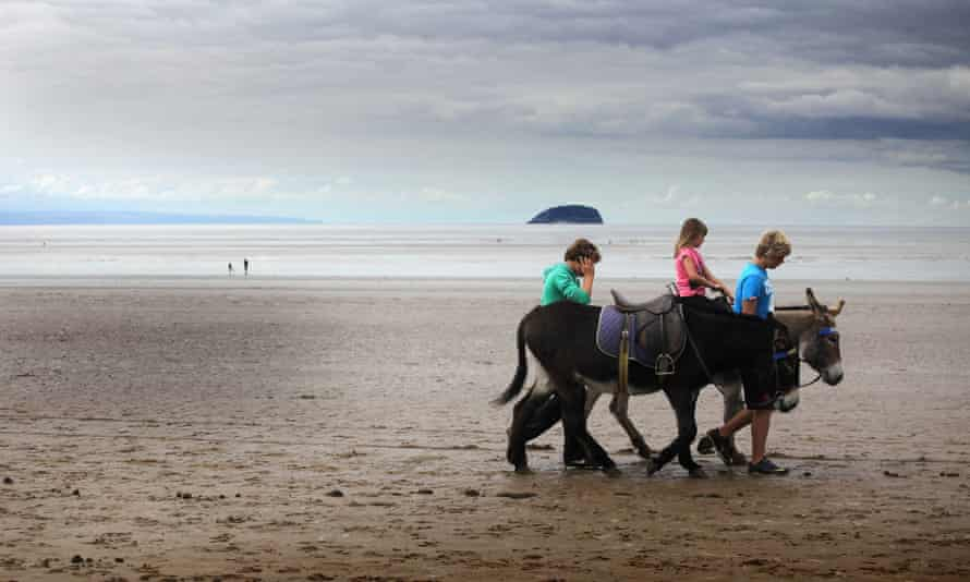 Holidaymakers take a donkey ride on the near deserted beach on August 30, 2011 in Weston-Super-Mare, England. According to weather experts the UK's summer has been one of the coldest for many years.