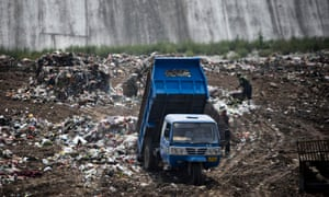 Rubbish is dumped at a site near a village in Zhanglidong, Henan province, China.