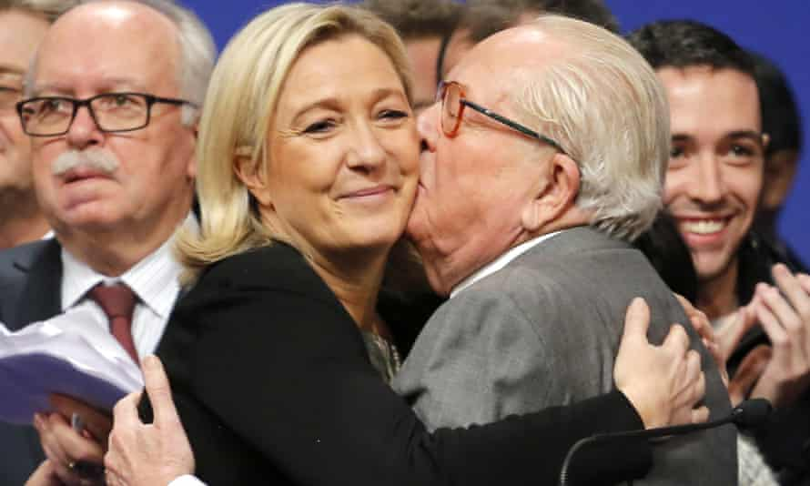 Front National leader Marine Le Pen is kissed by her father, Jean-Marie Le Pen