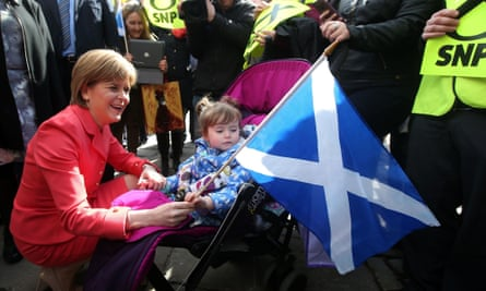 Nicola Sturgeon holds a Scottish flag while campaigning in Aberdeen.