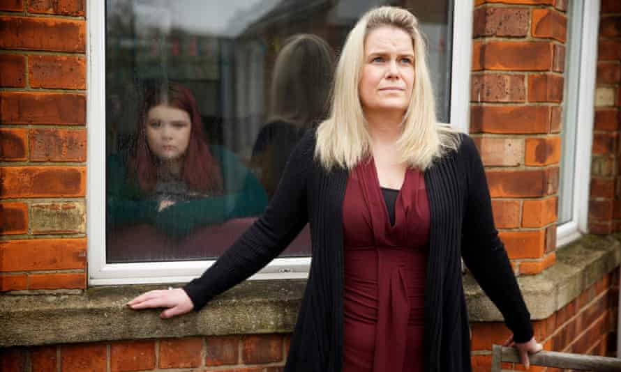 Sally Burke at home in Hull with her daughter Maisie, who has been forced to stay in a mental health hospital unit 100 miles away in Sheffield after her local facility was closed.