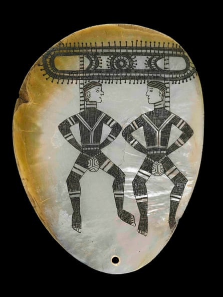 Pearl-shell pendant with dancing figures, pre-1926.