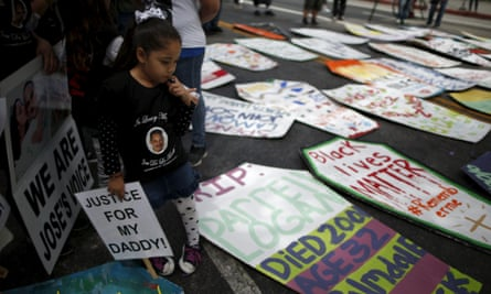 The five-year-old daughter of Jose de la Trinidad, 36, who was fatally shot by Los Angeles County sheriff's deputies, looks at cardboard coffins to commemorate the more than 617 people march organizers say have been killed by law enforcement in LA County since 2000, in Los Angeles, California April 7, 2015. REUTERS/Lucy Nicholson:rel:d:bm:GF10000051992