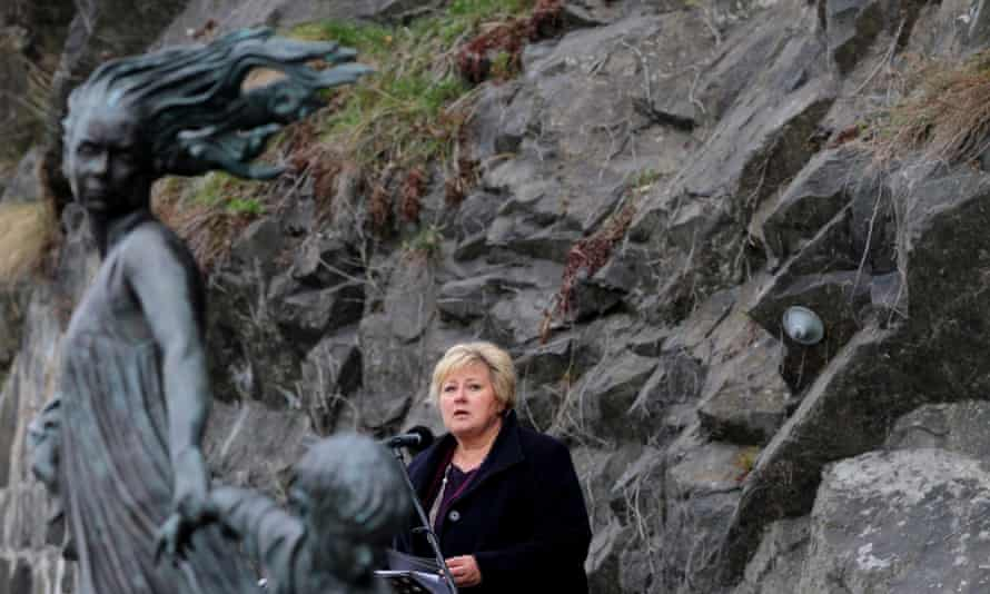 Norwegian Prime Minister Erna Solberg speaks during a remembrance ceremony. She has called Norway's treatment of Roma 'a dark part' of the country's history.<br>