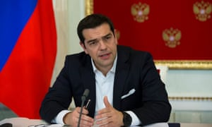 Greek prime minister Alexis Tsipras attends a joint news conference with Russian President Vladimir Putin.