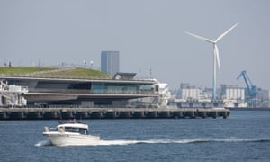 A wind turbine in Tokyo bay. Japan is to set a target of cutting emissions 20% by 2030 ahead of a climate summit in Paris.