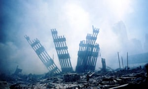 The rubble of the World Trade Centre smoulders after the terrorist attacks of 9/11, which are the subject of ENO's world premiere production of Between Worlds.