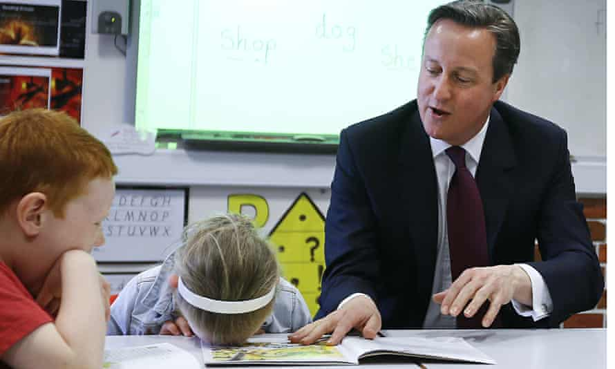 David Cameron reads to children