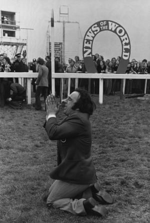 1975 Barry Ellison, head stable hand for the 7-2 favourite Red Rum, prays for the right result before the race. His prayers fell on deaf ears though as the 13-2 second-favourite L'Escargot, ridden by Tommy Carberry, won by a distance of 15 lengths to deny Red Rum a third consecutive win