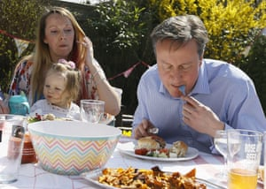 David Cameron eats a hot dog with a knife and fork