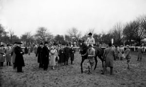 1956 Dick Francis on the Queen Mother's horse Devon Loch in the parade ring before the race