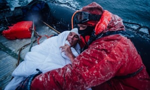 In this Feb. 19, 2015 photo, provided by 5 Swims Expedition, Lewis Pugh, of the United Kingdom, is wrapped in blankets to help warm his body in the Ross Sea in Antarctica. An extreme swimmer from Britain, Pugh completed the last of four swims in the ocean near Antarctica this month, including two that were further south than anybody had ever swum before.