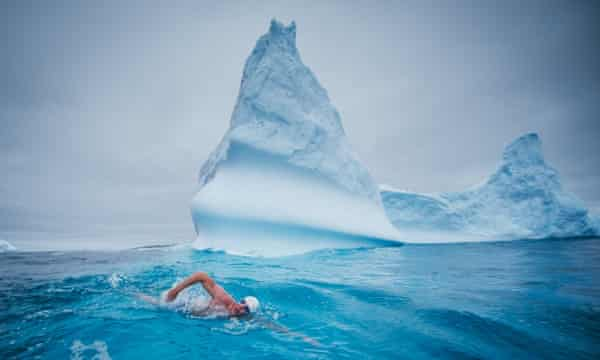 """Undated handout photo of British endurance swimmer Lewis Pugh who has appealed to Russia to lead the world in protecting the waters around Antarctica as he completed the last of five swims in the region's freezing seas, March 6, 2015. The final swim to campaign for a vast marine protected area in the Antarctic's """"pristine"""" Ross Sea saw Mr Pugh take to waters of 0C in just his Speedos to swim 500 metres off the coast of Peter I Island in the Bellinghausen Sea."""