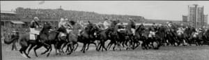 <strong>1940</strong> The 30 runners and riders gallop away from the start line. The race was won by Bogskar (No20 on left of image), a 25/1 shot ridden by the Royal Air Force sergeant Mervyn Jones