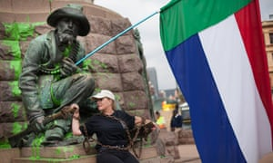 Afrikaans singer Sunette Bridges chains herself to a vandalised statue of Paul Kruger in Church Square in Pretoria, South Africa.