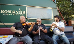 Musicians of the Romanes Gypsy circus on their way through Paris.