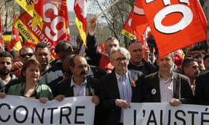 "French CGT trade union leader Philippe Martinez, centre left, flanked by French union FO, Force Ouvriere, secretary general Jean-Claude Mailly, right, hold a banner reading ""against austerity"" as part of a demonstration march in Paris."