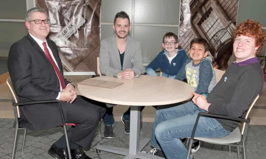 Andrew Parker, MI5 director general, with presenter Barney Harwood and Project Petra candidates Jamie, Finley and Reuben.
