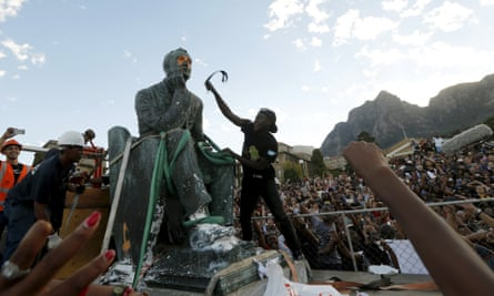 The statue of Cecil Rhodes was daubed with paint and slapped during the removal ceremony