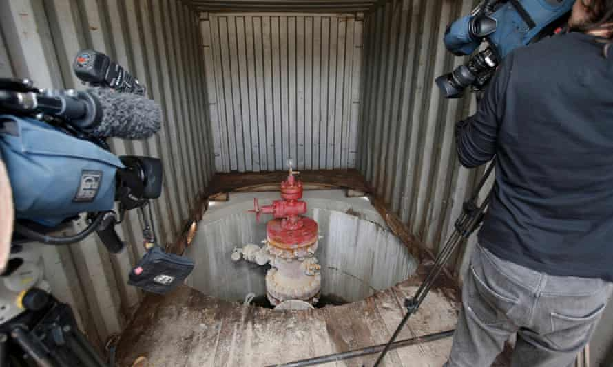Television crews video an exploratory well-head at Horse Hill, a site near Gatwick airport in southern England.