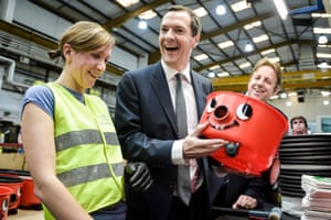 George Osborne admires his handy-work after putting together a Henry vacuum, in Exeter.