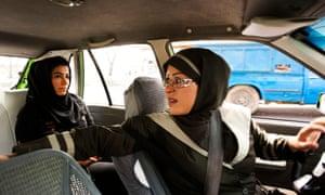 A female taxi driver fetches a passenger in Tehran, Iran.