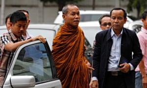 Thai Buddhist monk Phra Buddha Issara arrives at a police stationin Bangkok