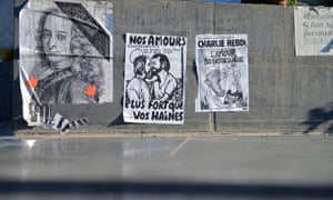 Poster of Voltaire (left) left by the public near Charlie Hebdo's offices in Paris a month on from the terrorist attacks which left 12 dead in February.