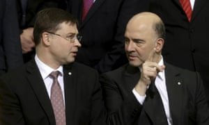 European commission vice-president Valdis Dombrovskis (left) speaks to European commissioner for rconomic and financial affairs Pierre Moscovici in Riga.