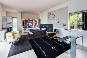 The living room of E1027 with furniture and rugs designed by Eileen Gray – and, on the far wall, Le Corbusier's mural.