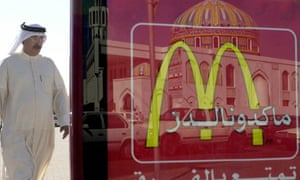 McDonald's sign that reflects the image of Al-Saadeq Mosque in Manama, Bahrain.