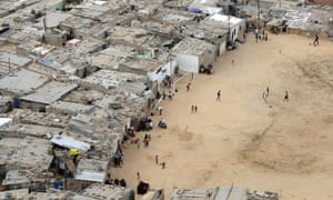 Residents walk in the shanty town of Boa Vista in the Angolan capital Luanda. Press freedom in the country is limited.