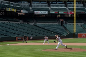 The Orioles relief pitcher throws in the final inning against the Chicago White Sox in an empty Oriole Park at Camden Yards