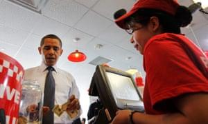 President Barack Obama orders a hamburger at Five Guys in Washington.