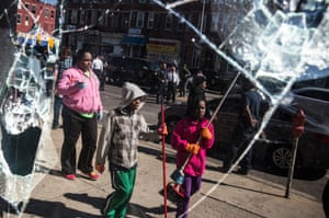 People turned out to help clean up the debris on the streets of baltimore on April 28