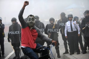 A protester rides his bike in front of a police line at North and Pennsylvania Avenues on Monday., April 27