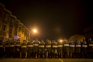 Police line up shortly after the deadline for a city-wide curfew at North Ave and Pennsylvania Ave on April 30