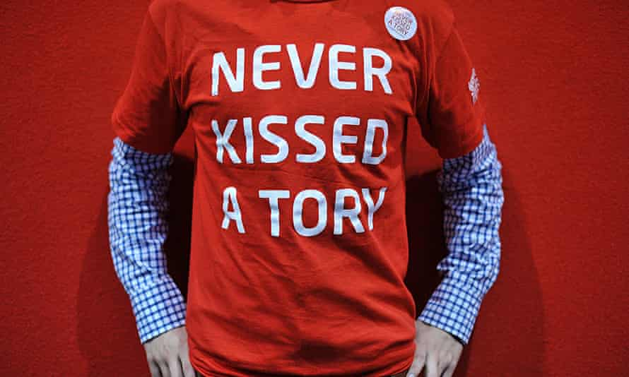 A Labour supporter wearing a 'never kissed a Tory' t-shirt