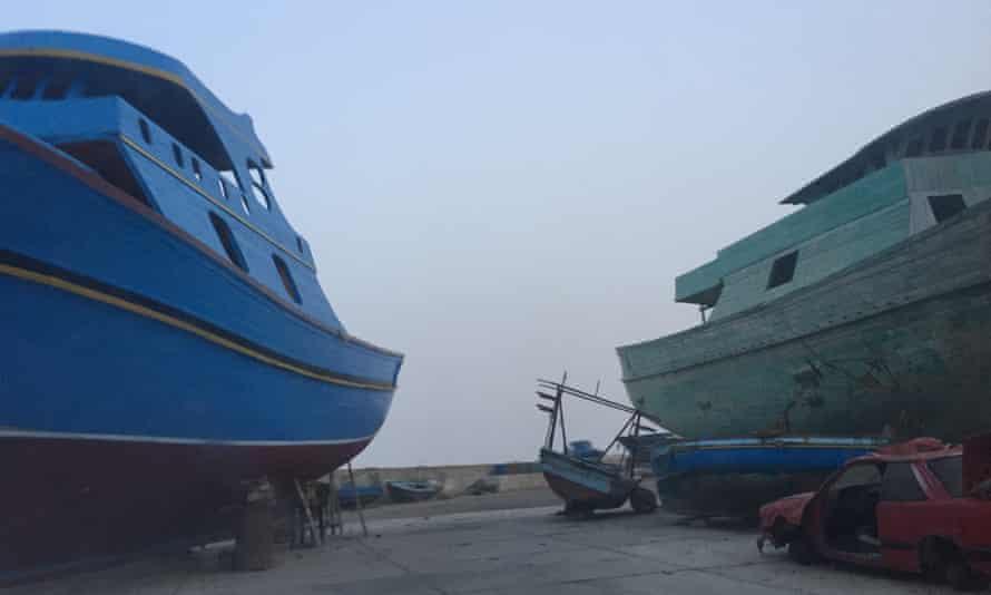 Boats awaiting maintenance in the fishing port of Zuwara