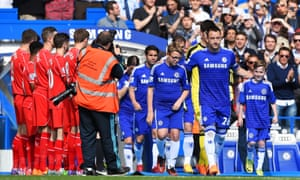 John Terry leads out his team through a guard of honour by the Liverpool players.