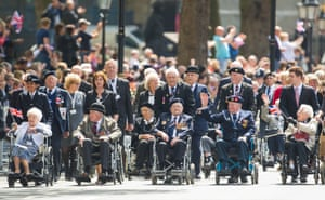 Veterans wave to the crowds during the VE Day Parade in Whitehall, London
