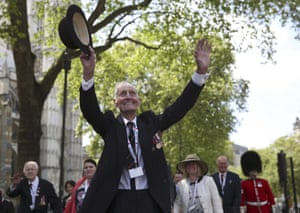 A war veteran gestures to the crowds