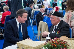 Prime Minister David Cameron speaks to RAF veteran Edward Bullock, 89, in a marquee hosted by the Royal British Legion in St James's Park