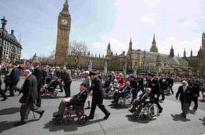 Veterans parade past parliament